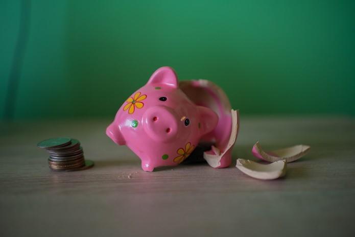 Sparschwein geköpft Restsschuld Kredit abbezahlen